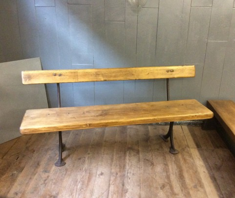Rustic pine and wrought iron bench