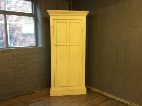 Painted one door tall cupboard
